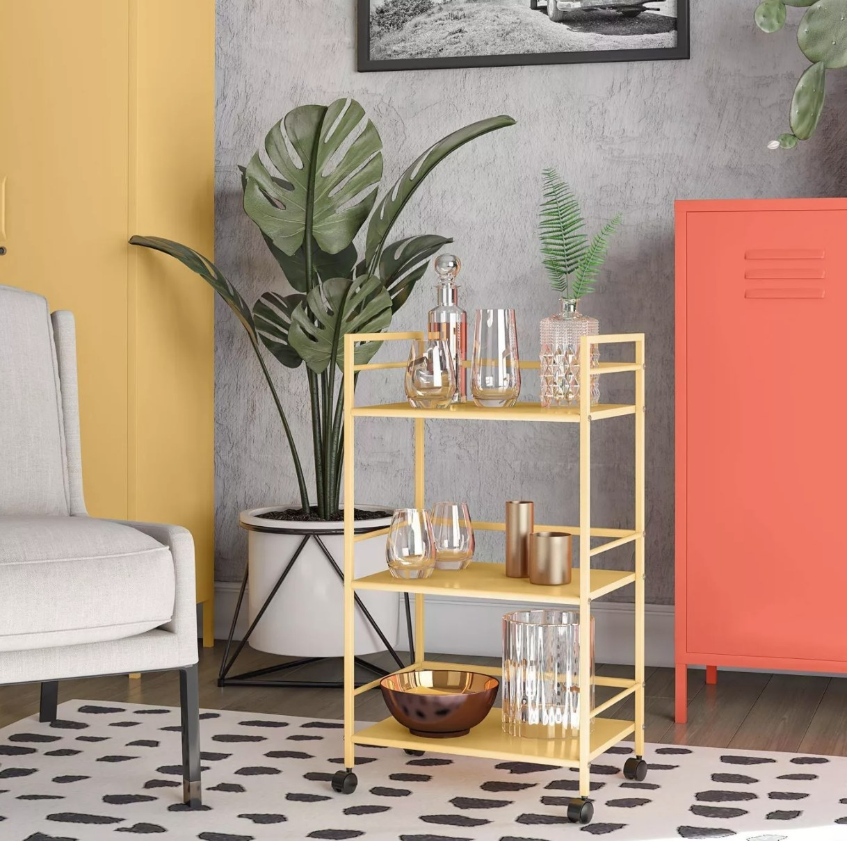 The yellow metal bar cart