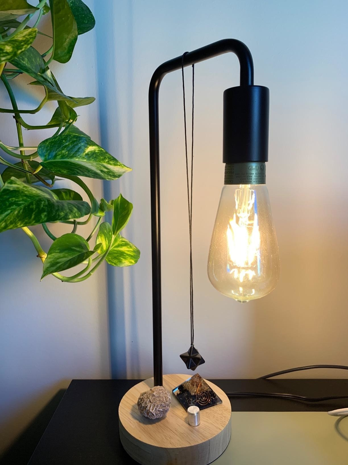 a desk lamp with an exposed bulb