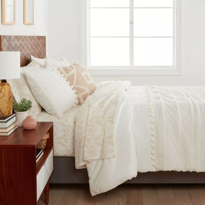 The bedding set on a bed