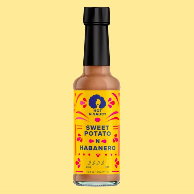 A bottle of Hot N Saucy Sweet Potato N Habanero sauce