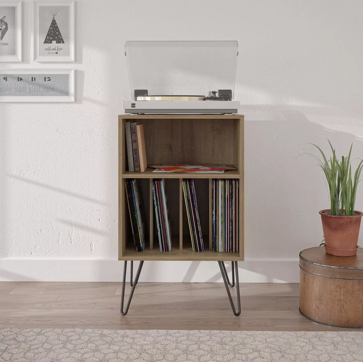 The reclaimed oak vinyl record stand holding a record player and tens of records