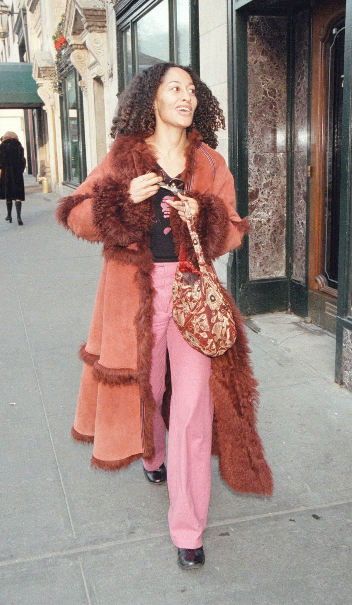 Tracee Ellis Ross in a long suede and lambskin coat