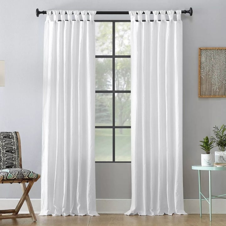 The curtains hung up in a living room