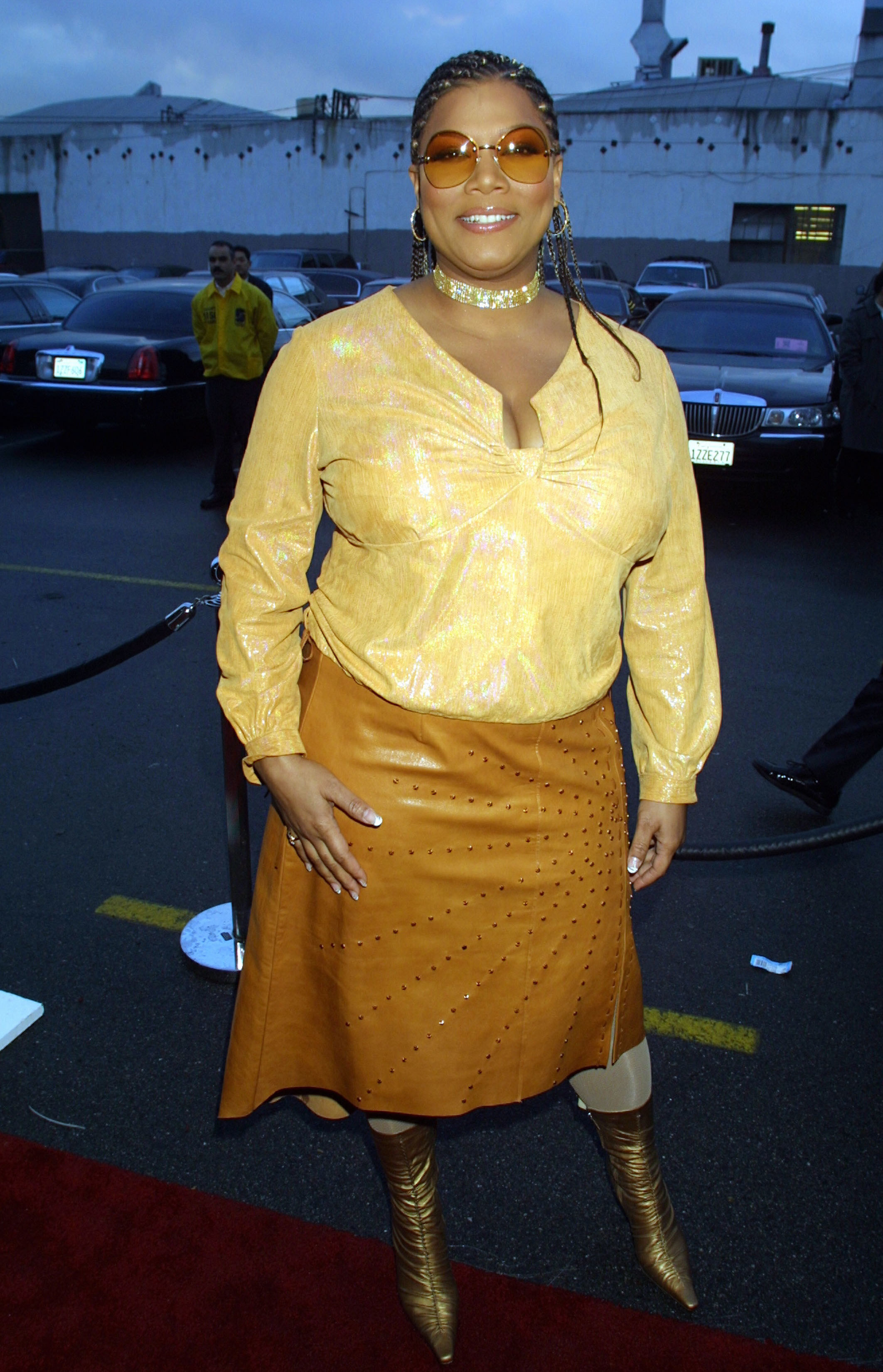 Queen Latifah wearing studded leather and sunglasses on a red carpet