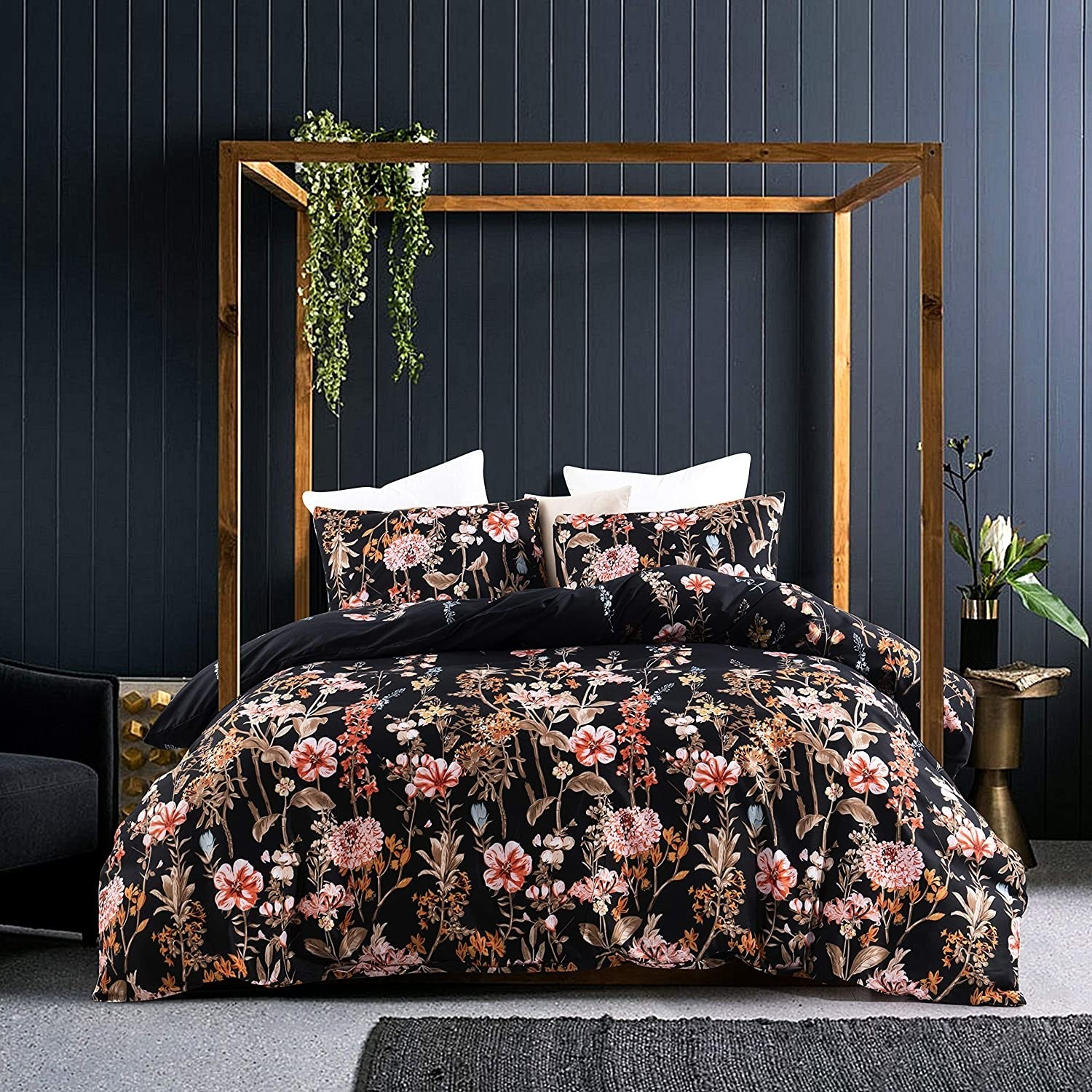 a black comforter with pink florals on it