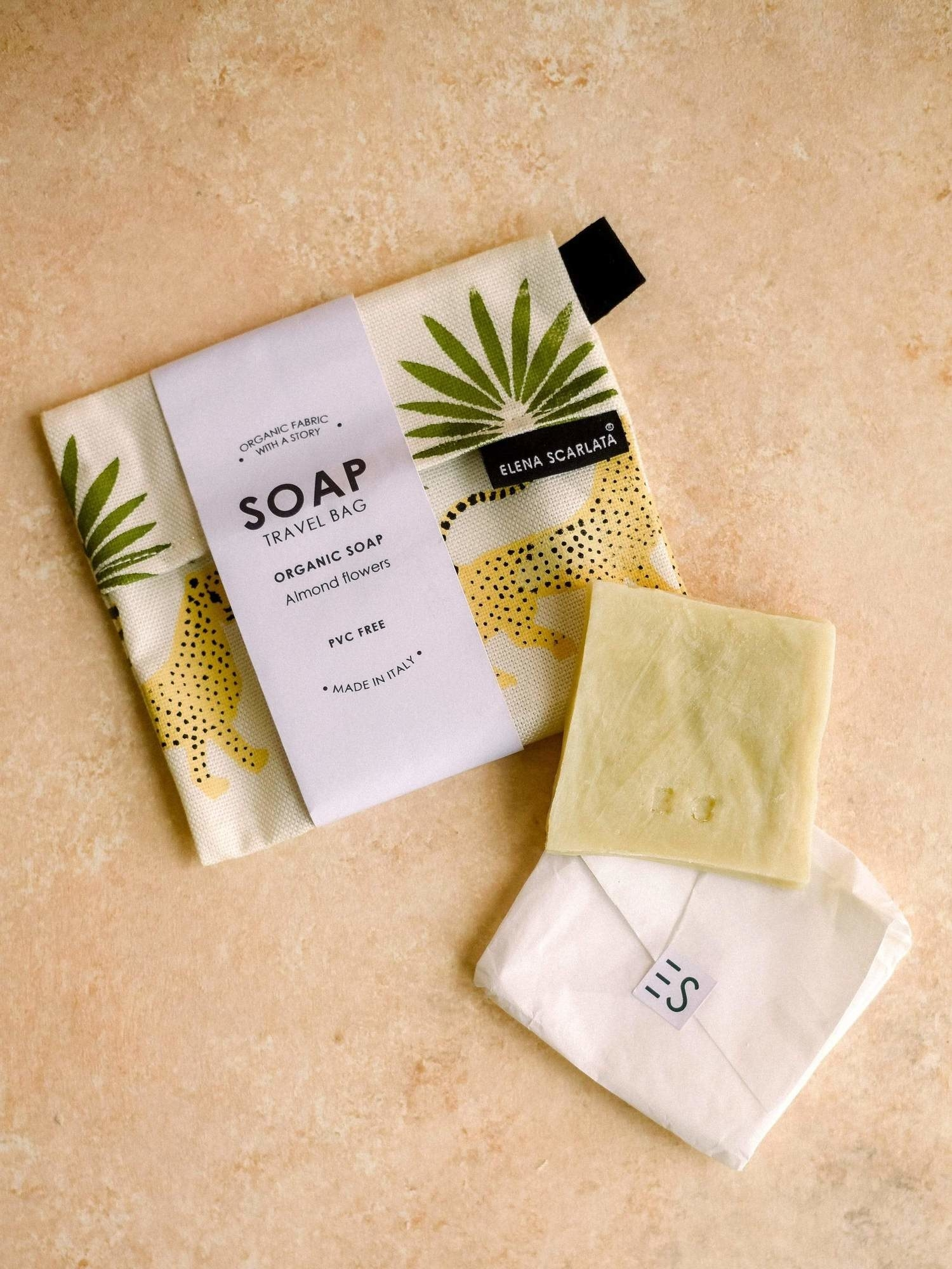 square bar of soap with a pouch with leopard and leaves