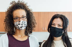 Two teachers with masks on in a science classroom