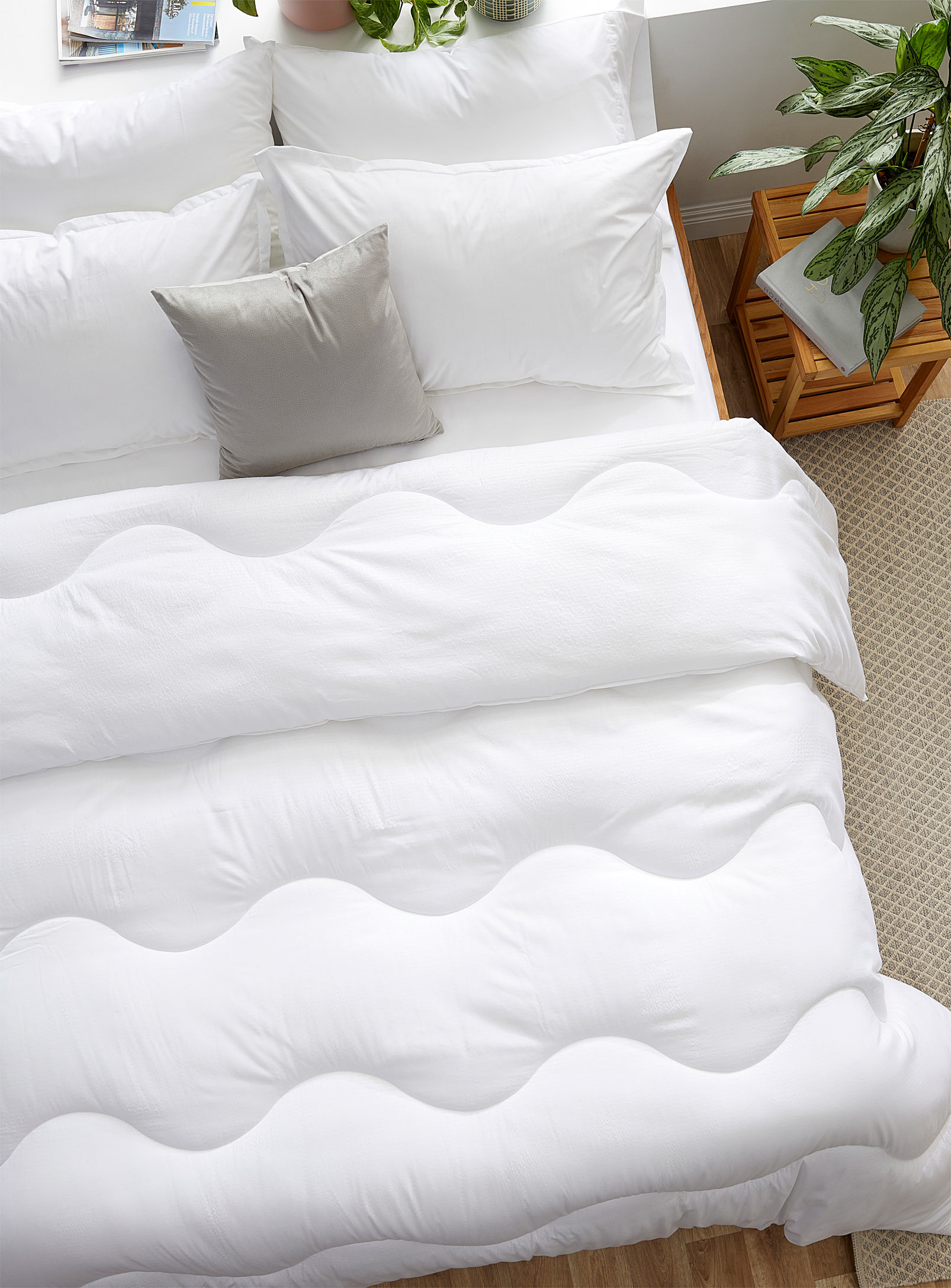 A top-down view of the fluffy duvet blanket on a bed