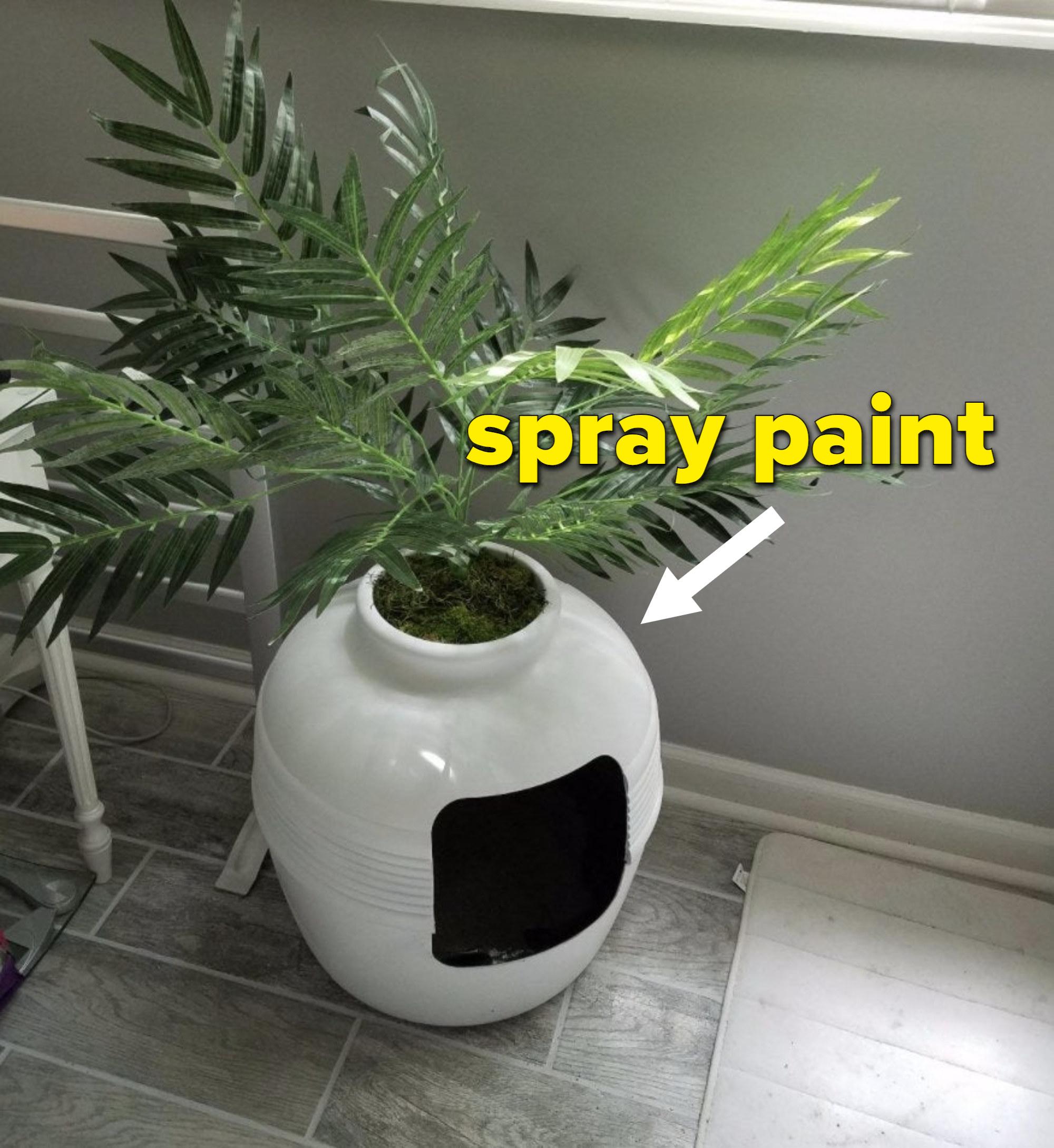 A white hidden litter box planter