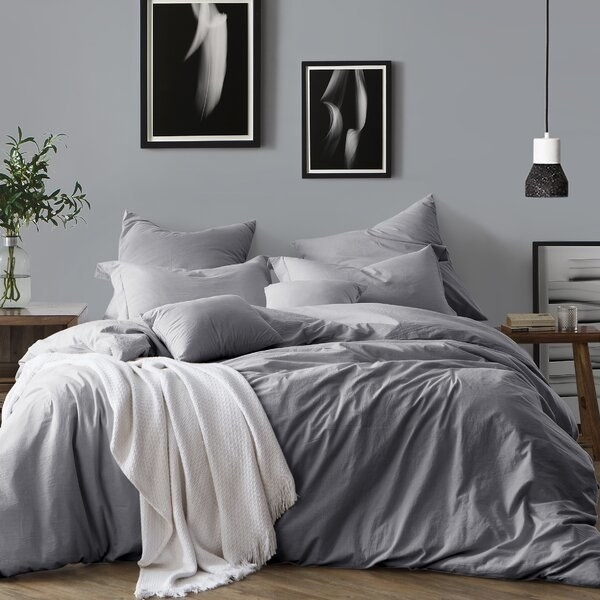 bed with grey duvet cover and pillows