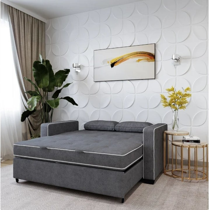 Gray convertible couch in full size bed position