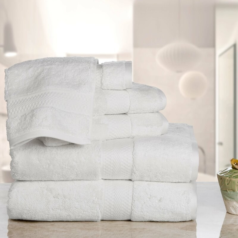 Six piece set of towels sitting on the counter