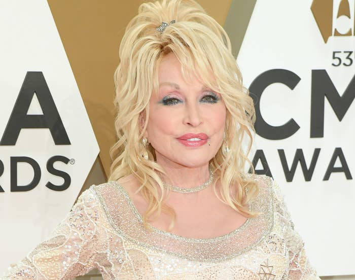 Dolly smiles in a shimmering gown on a red carpet
