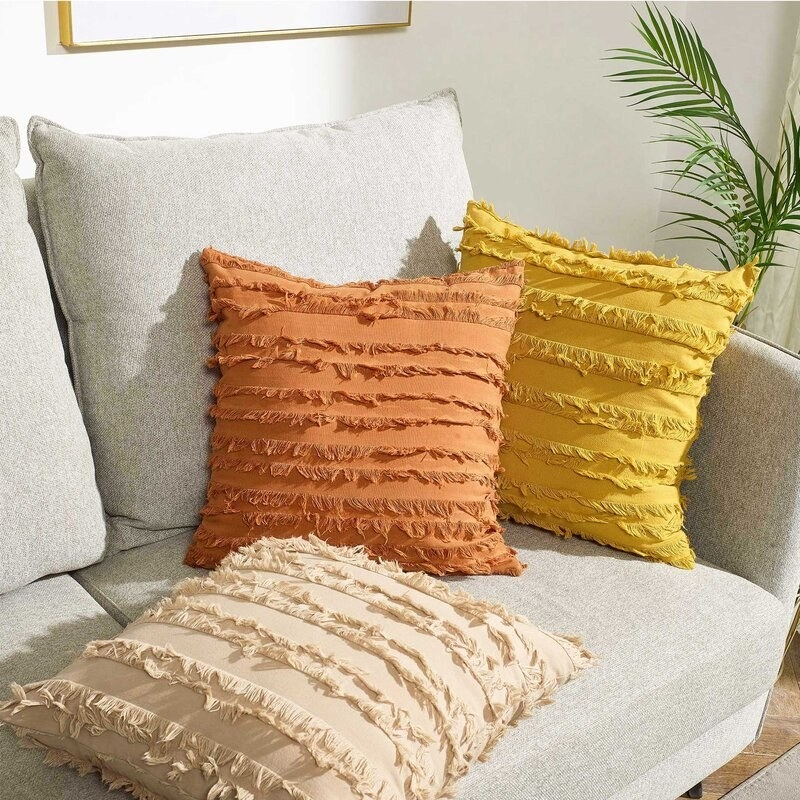 Throw pillows sitting on couch