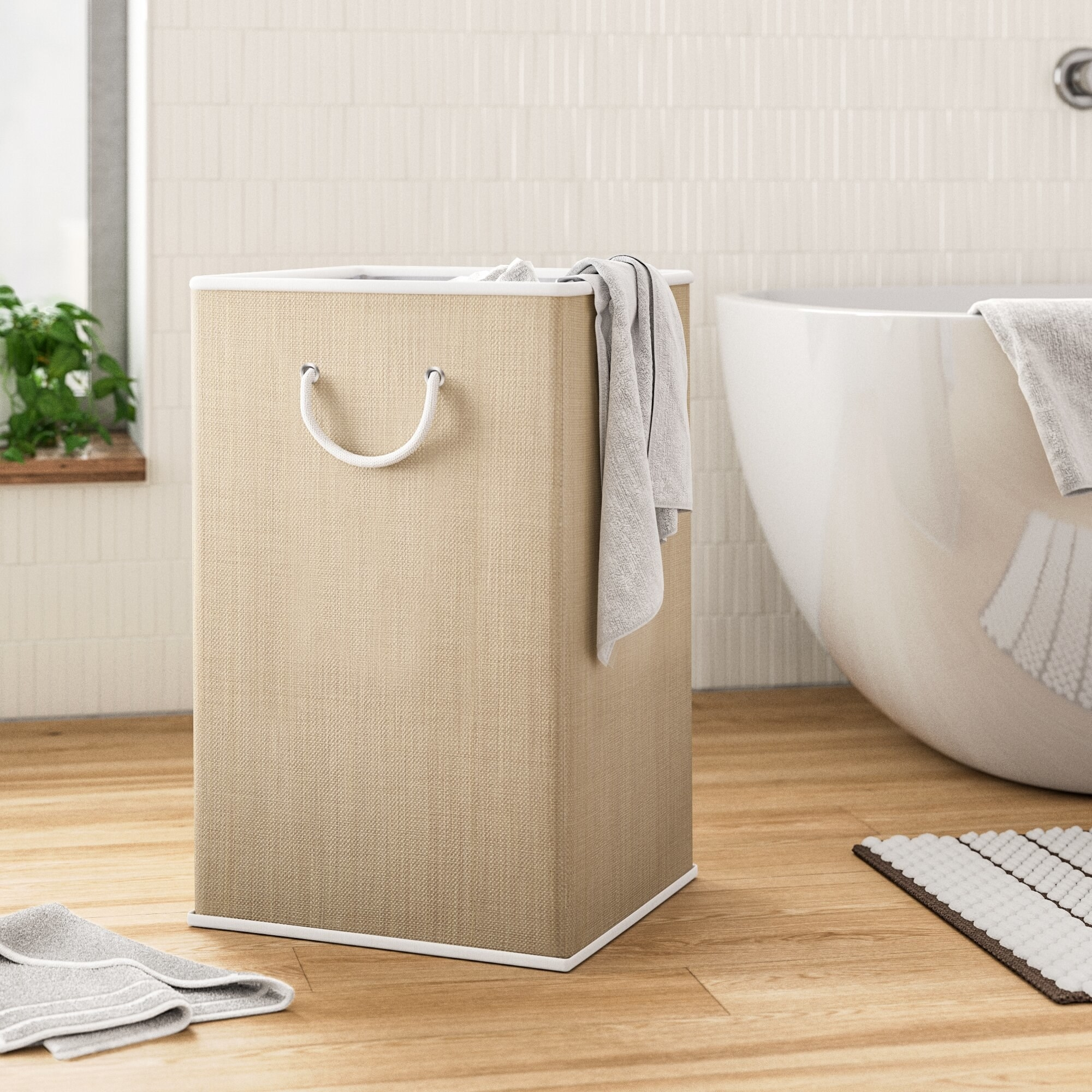 Collapsable laundry basket in bed room