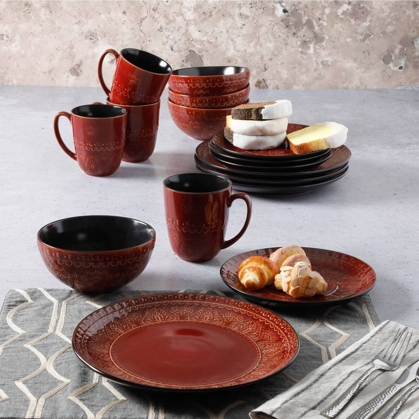 set of red cookware with floral design on it