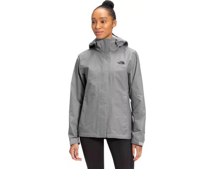 a model wearing a grey waterproof jacket
