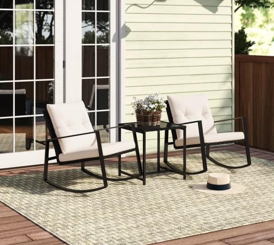 Black bistro set with two rocking chairs and table