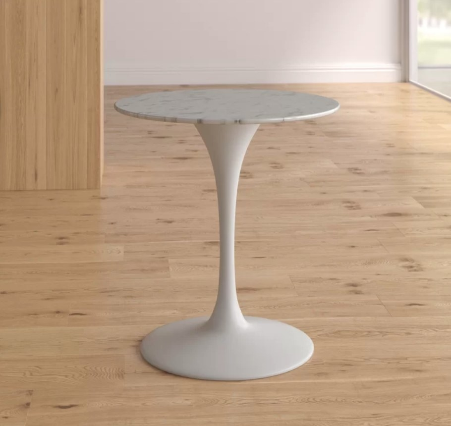 Round white dining table with marble top
