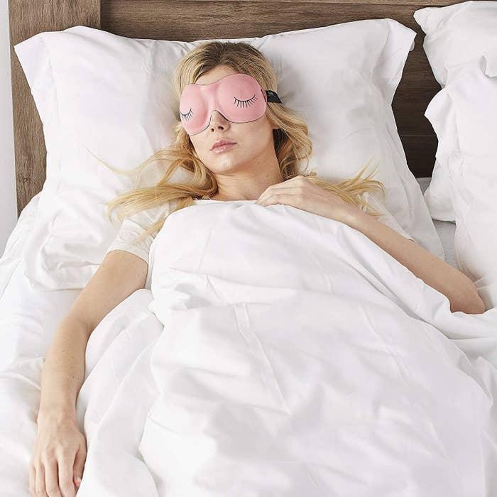 Someone sleeping while wearing the contoured eye mask
