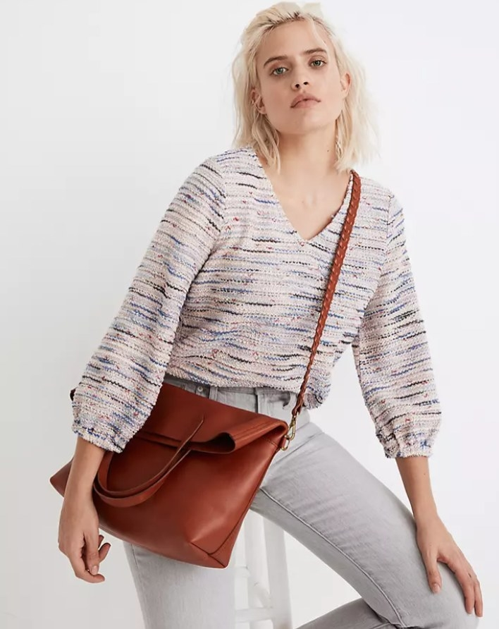 A model wearing the tote slung across her body