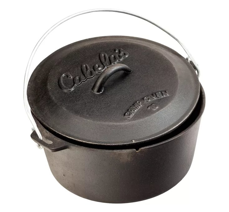 a black camping dutch oven with a metal handle