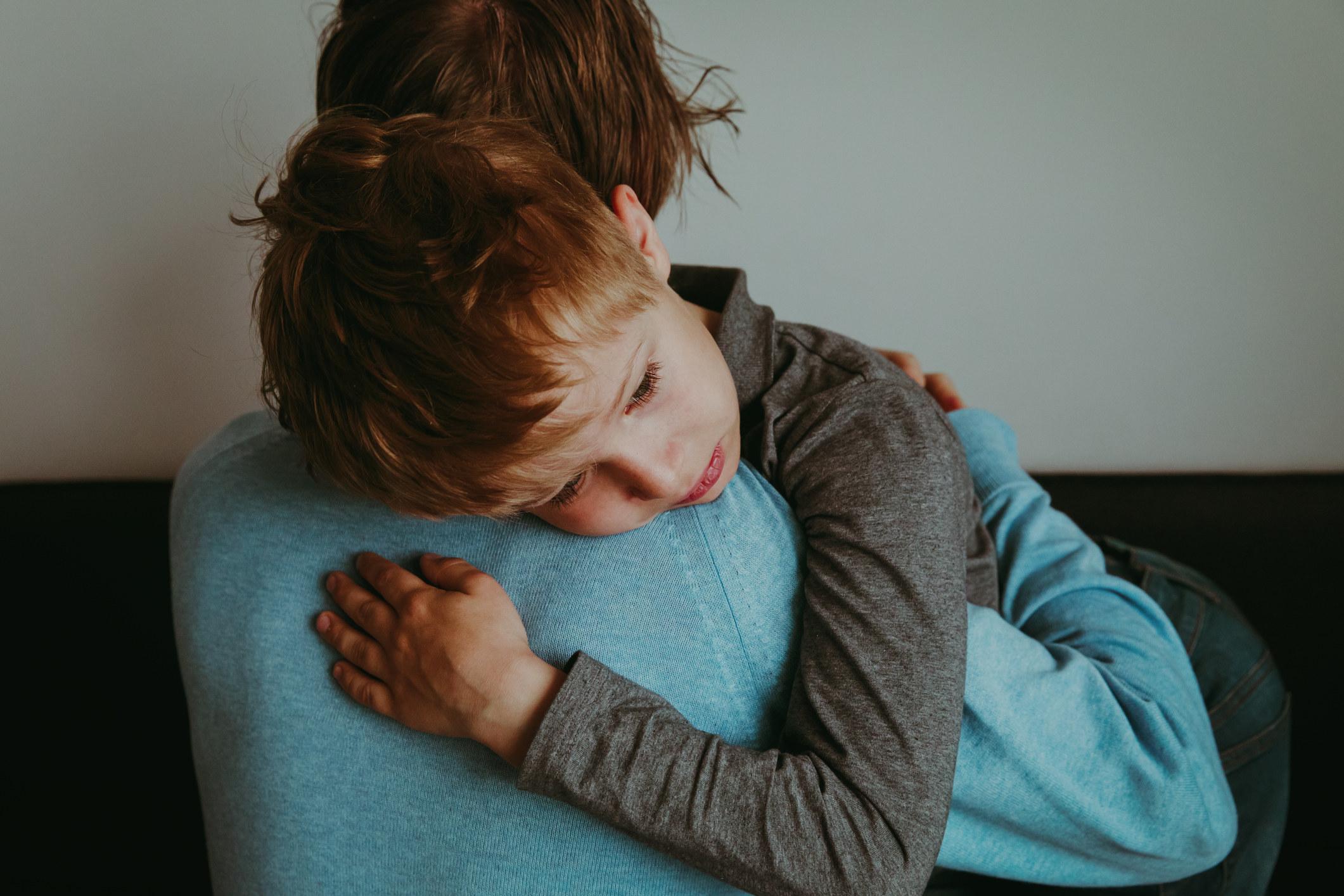 A parent comforting a sad child