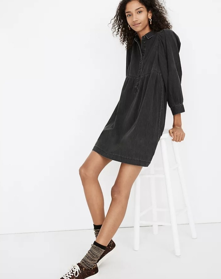 The shirtdress on a model wearing low top sneakers and mid calf socks