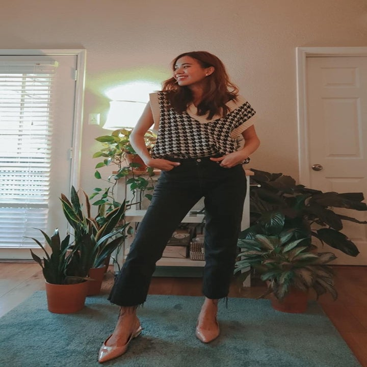 reviewer wears same sweater with raw hem jeans and kitten toe pumps