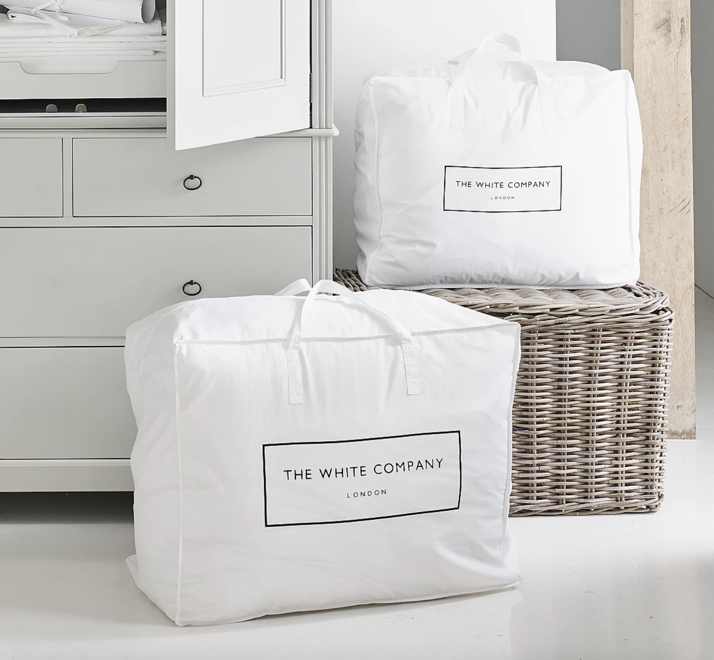 two large cotton storage bags in a laundry room