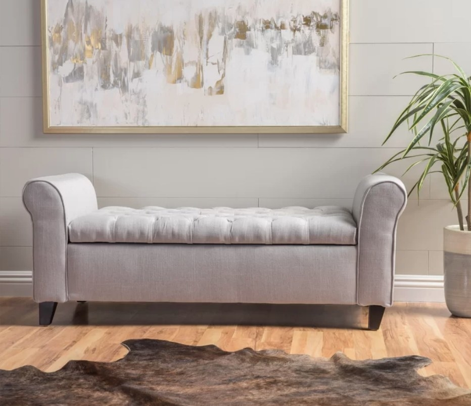 Gray upholstered storage bench