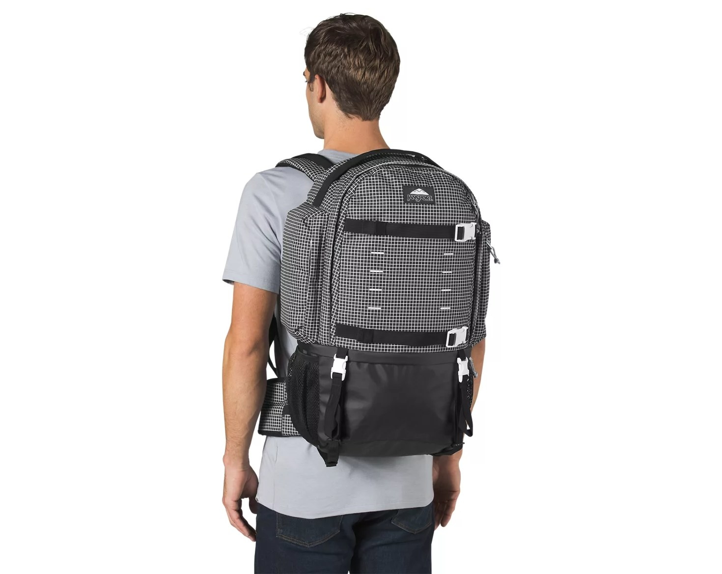 a model wearing the gray and black backpack