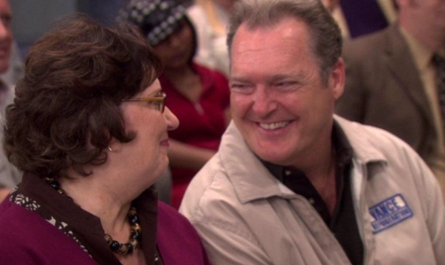 Bob and Phyllis staring into each other's eyes and smiling
