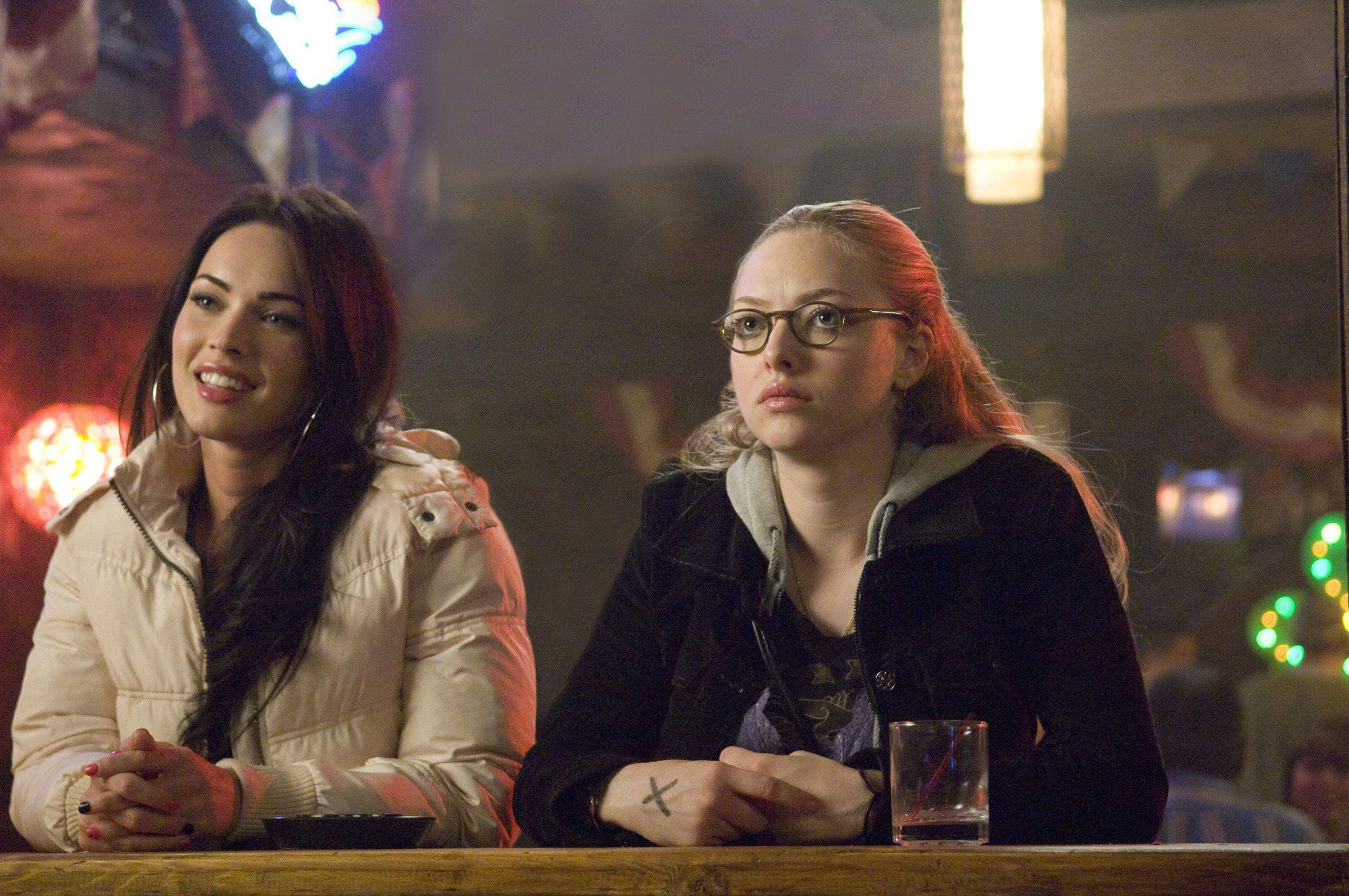 Megan Fox and Amanda Seyfried in the movie jennifers body. in the movie they are both at a bar.
