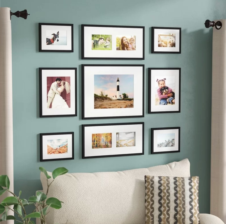 Black picture frames on teal wall