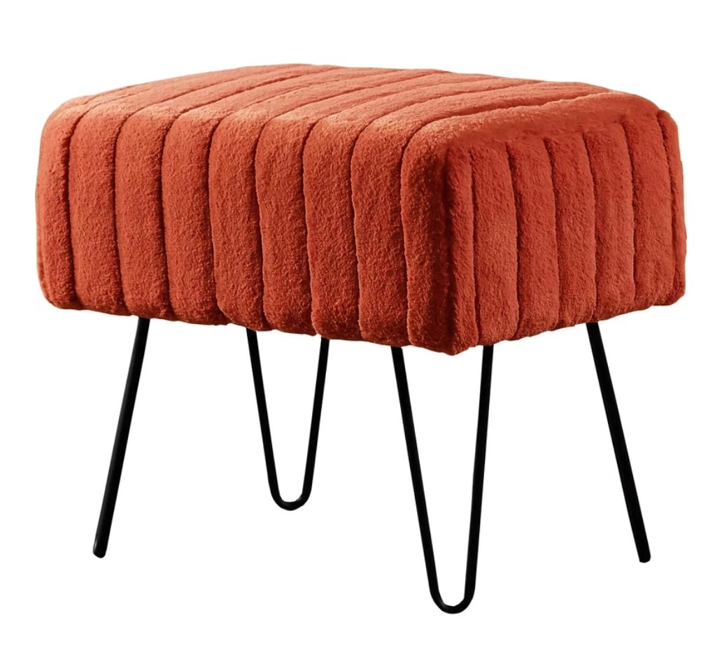 Faux fur orange top ottoman with black legs