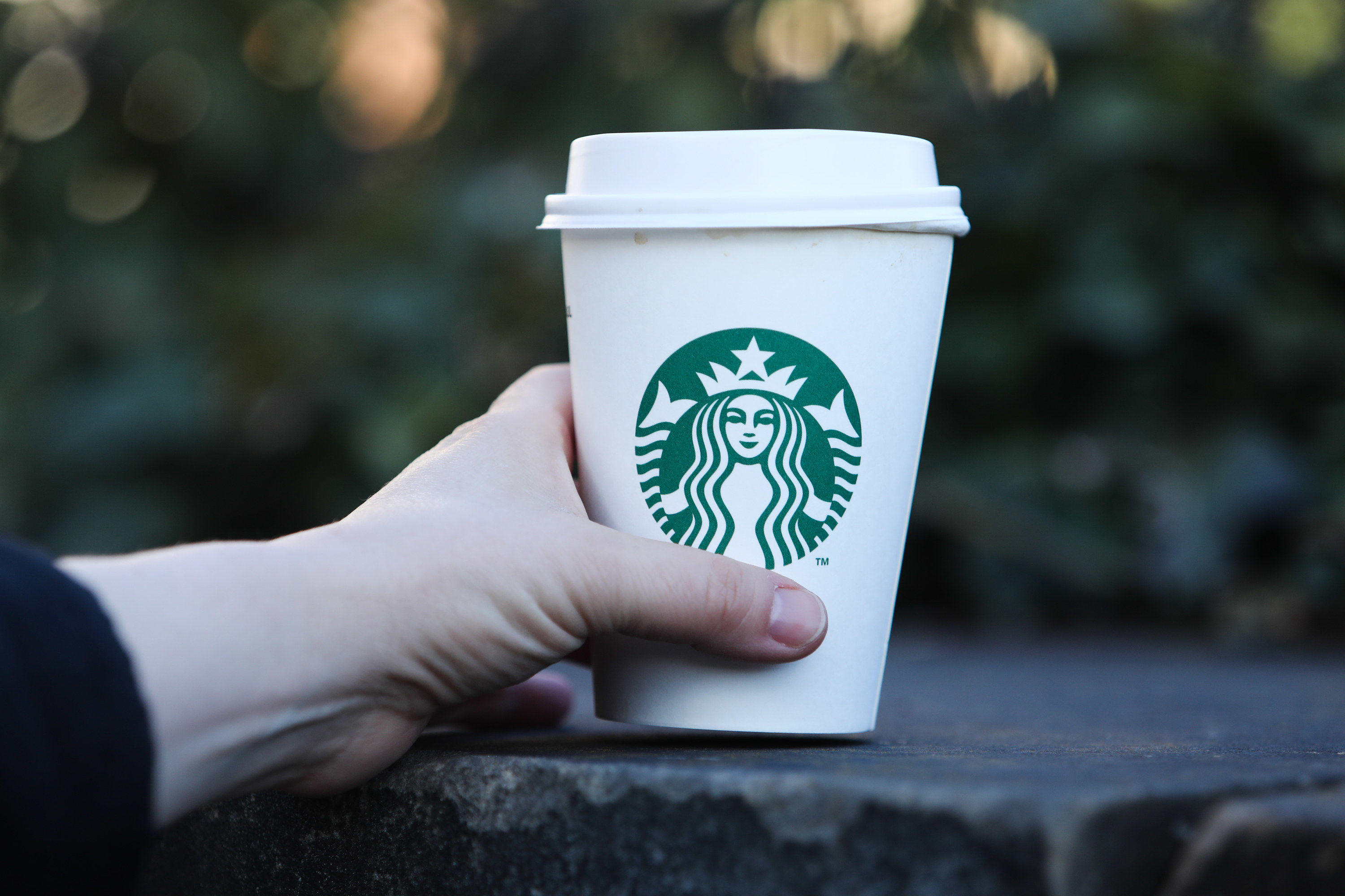 Someone holding a Starbucks cup