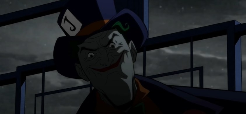 Joker smiling with a purple top hat on