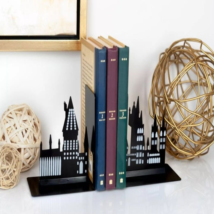 The bookends supporting books on a mantle