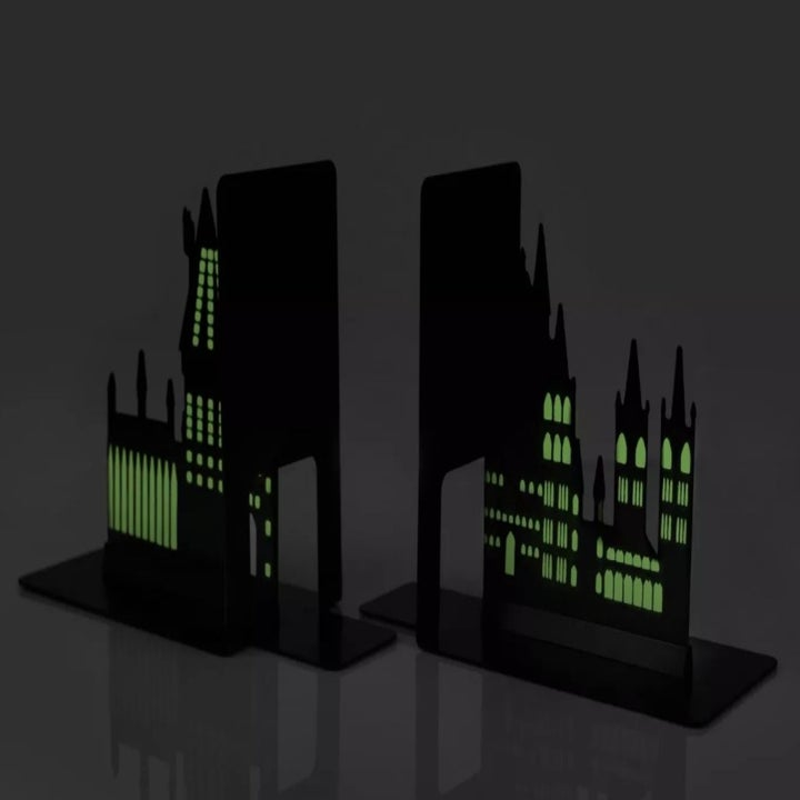 The bookends in the dark displaying how they glow