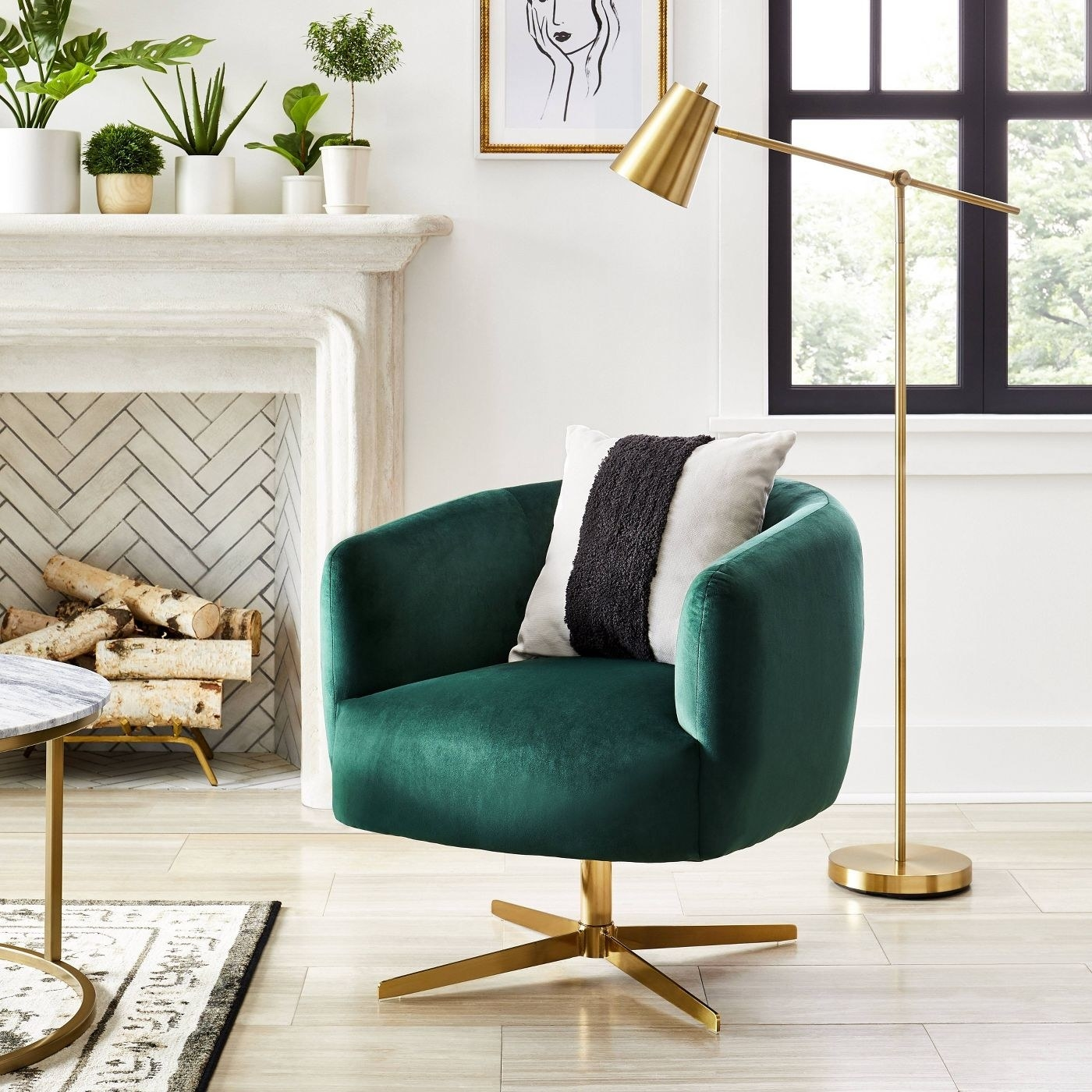 A green velvet swivel accent chair in a living room