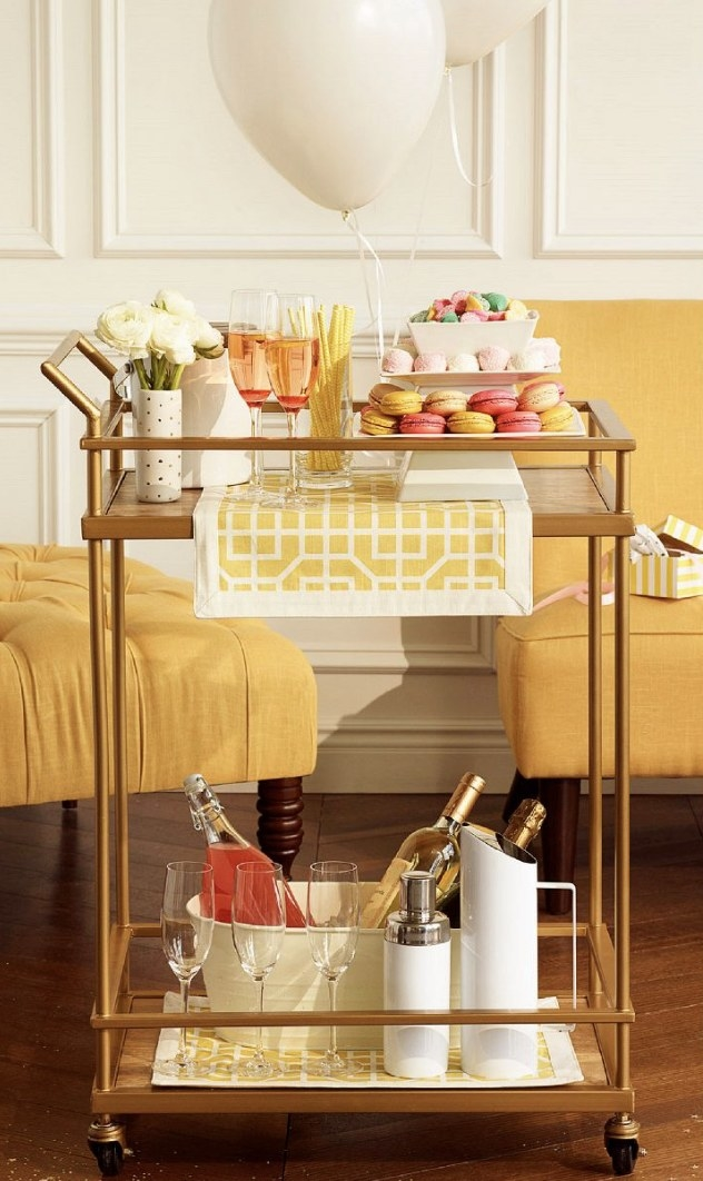 A wood and gold finish bar cart