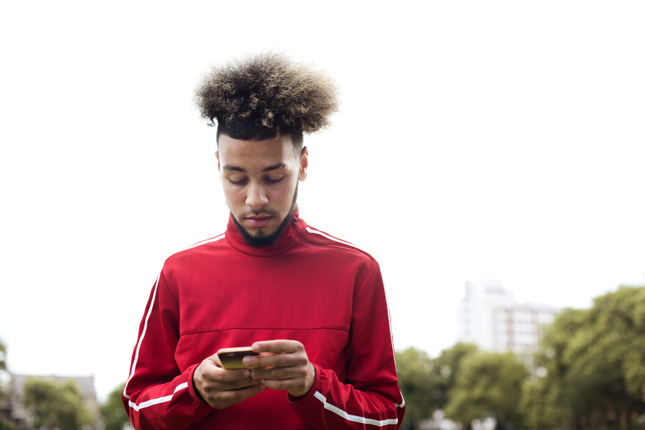 A young man texting
