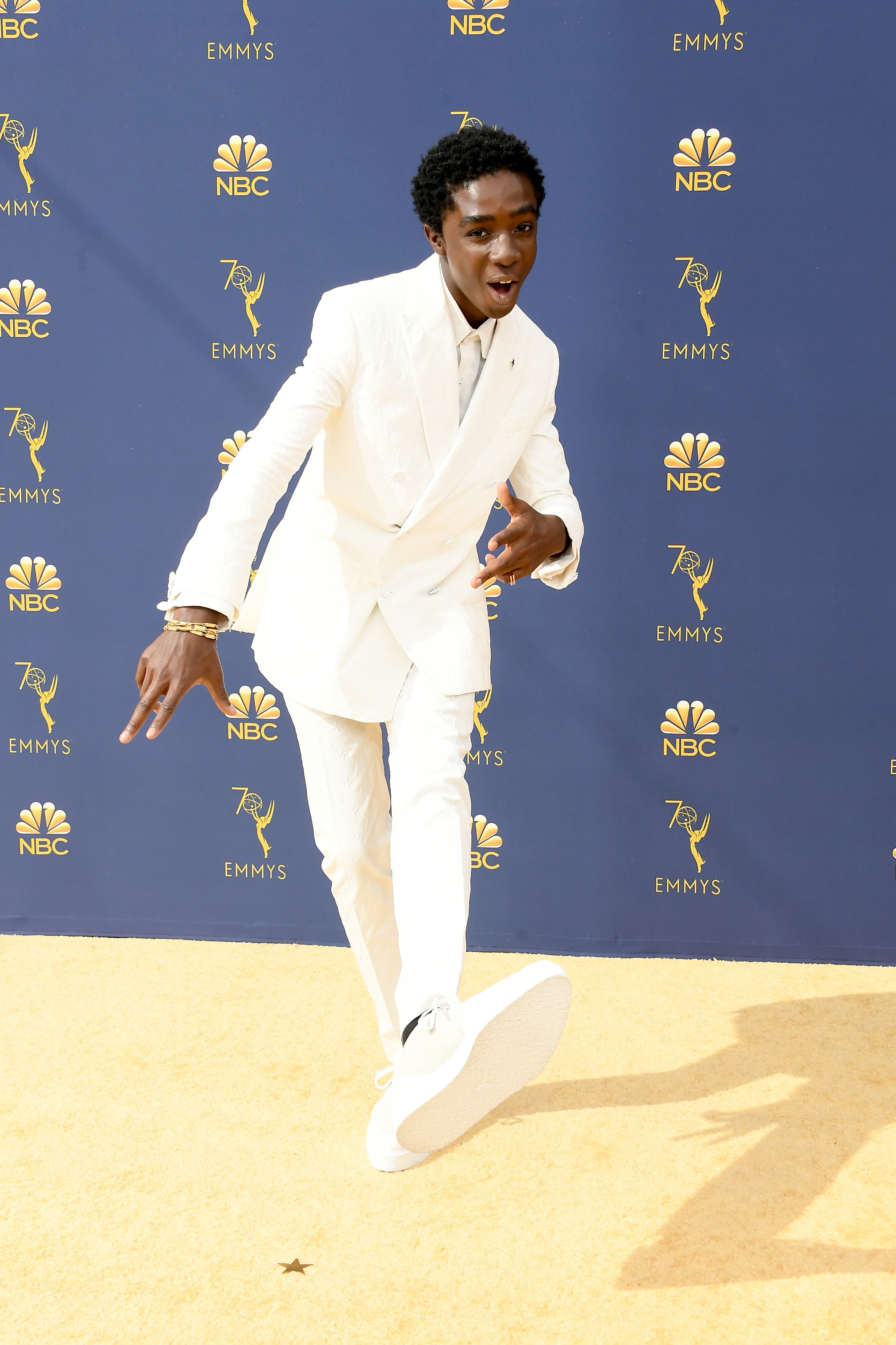 Caleb is wearing a head-to-toe monochromatic white suit at the Emmys.