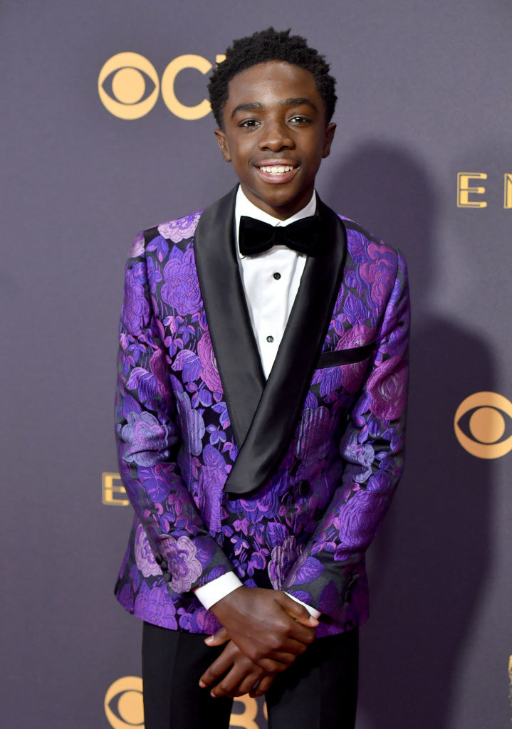 Caleb is wearing a floral printed tuxedo jacket at an awards show.