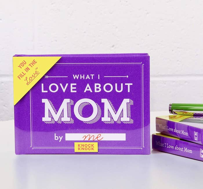 """the small purple book titled """"What I love about mom"""" with a blank after """"by"""" so you can fill in your name"""