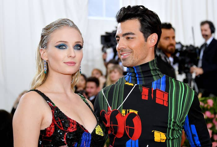 Joe adoringly looks at Sophie while at an event