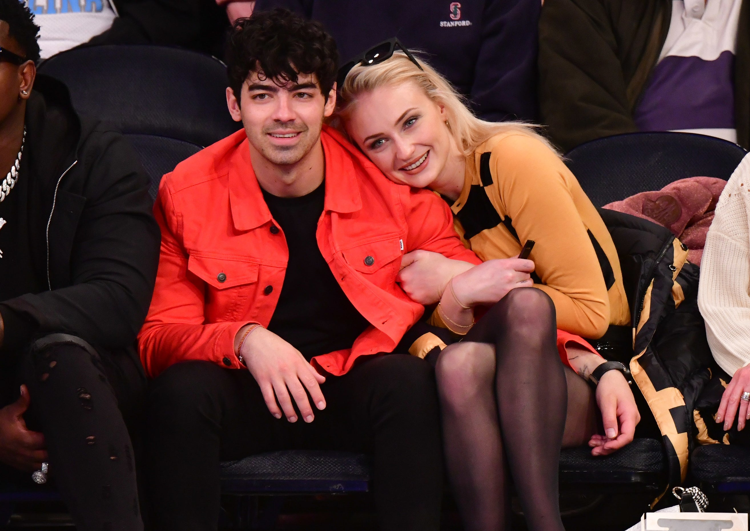 Sophie cuddles up to Joe while sitting at an event