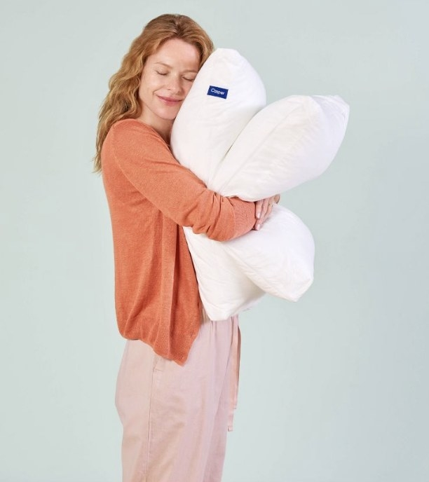 A woman hugging a memory foam pillow