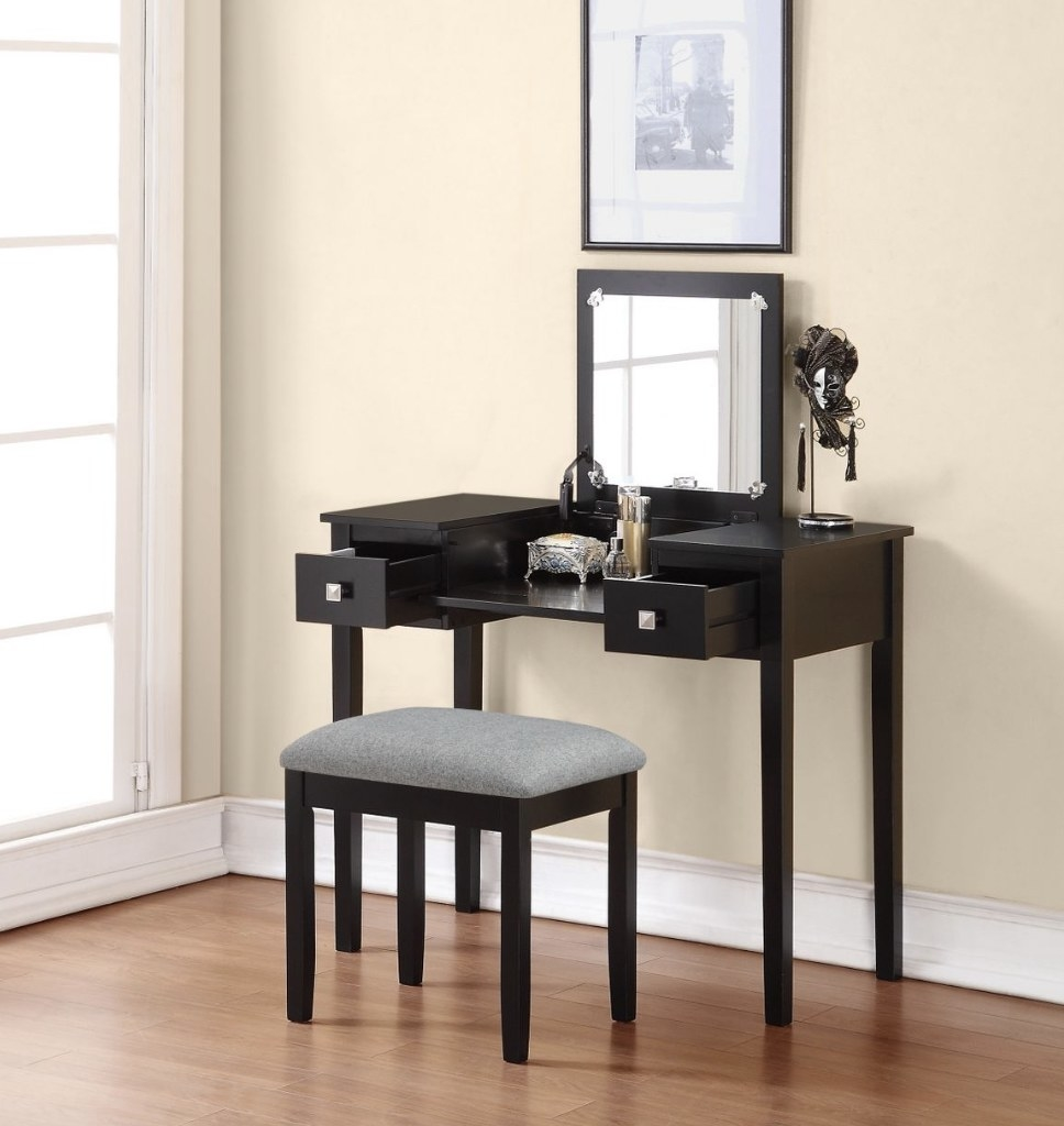 A black vanity with stool